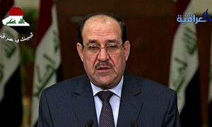 A grim-faced Nouri al-Maliki speaks on Iraqi TV