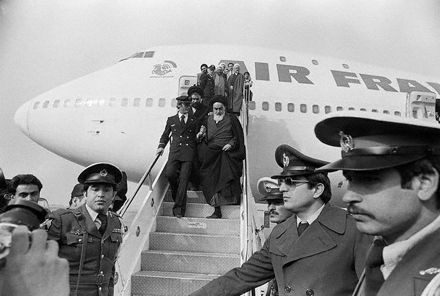 Ayatollah Khomeini Stepping Down from Plane