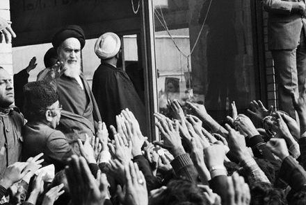 Ayatollah Khomeini Waving to Supporters