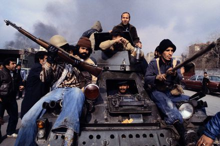 Revolutionaries on Tank in Tehran