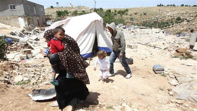 (แฟ้มภาพ ชีวิตของครอบครัวชาวปาเลสไตน์หลังจากที่อาคารบ้านเรือนถูกอิสราเอลรื้อทำลาย)