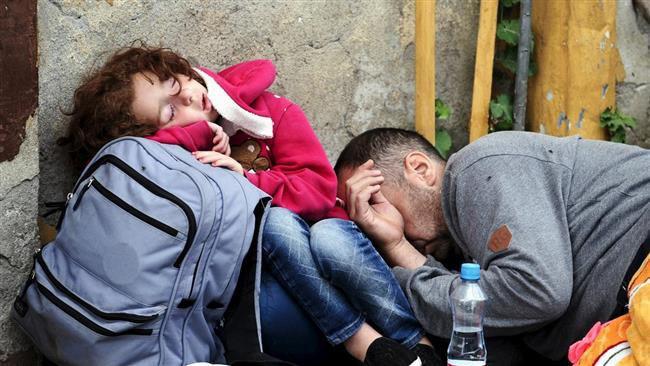 (ภาพ) ผู้ลี้ภัยถักเหนื่อยที่สถานีรถไฟเกฟเกลิยา มาซีโดเนีย เมื่อ 21 สิงหาคม 2015